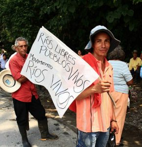 A protest against the Ituango hydro dam being developed by EDC client Empresas Públicas de Medellín. The dam nearly ruptured this spring, forcing the evacuation of 25,000 people. Photo by Agencia Prensa Rural.